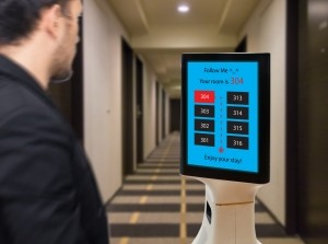 Robot butler leads hotel guest to room
