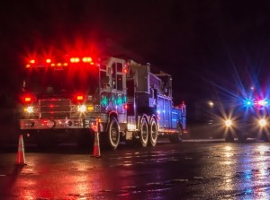 First responder's vehicles with lights on at night, photo by Gregor Doerr / Adobe Stock