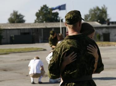 woman hugging soldier